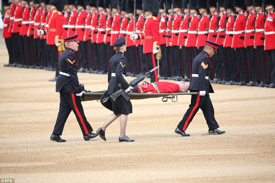 3526BD5000000578-3636565-The_soldier_was_stretchered_away_by_officials_to_receive_medical-a-15_1465646069021