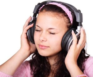 11704-a-beautiful-girl-listening-to-music-with-headphones-pv