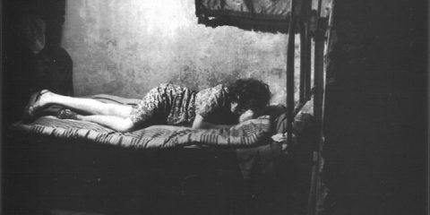 interior_of_a_brothel_in_naples_italy_1945_4_-_prostitute_on_bed