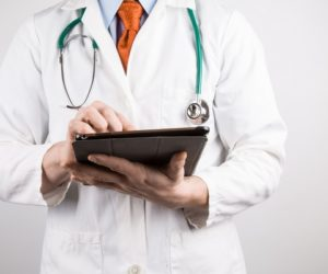 doctor-with-tablet-1461913089jcx