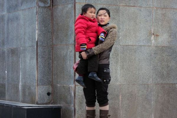 """Chen Xiaotian with his mother before he became ill A Chinese mum who nursed her dying son for two years even though she was seriously ill herself has been cured after doctors used the boy's kidney when he died to save her life. The tragic story started when Chen Xiaotian from Jinzhou city in Hubei province in central China was diagnosed as having a malignant brain tumour aged just five. He was treated and given an operation and for a few months it seemed that everything was well, but then the tumour returned with a vengeance and doctors told his parents there was little chance he would survive. In addition his mother Zhou Lu, 34, had been diagnosed as suffering from kidney failure that left her permanently ill and in need of dialysis treatment. Despite her illness however she continued to care for her son, taking him for regular treatment at the hospital as he gradually worsened. Eventually he became blind and shortly before he died had become bedridden and virtually paralysed, with his mother and grandmother having to do everything to care for him. Grandma Lu Yuanxiu, 57, said: """"The doctors approached me rather than his mother because of the sensitive nature of the issue. They told me that my grandson not survive but his kidneys could help his mother and also save to other lives as well. """"I discussed it with Zhou and she refused point-blank, she absolutely didn't want to hear any talk of that happening."""" But the Gran had enlisted the help of her grandson who had told his mother: """"I want to save your life."""" In tears, his mother had agreed to the doctor's proposal saying that what changed her mind was the thought that if her son was to die, part of him would live on in her. Doctors confirmed that the tissue match was perfect and when he died on April 2, he was quickly moved to the operating theatre where his kidneys and liver were removed donated to his mother and two other people. The second kidney went to a 21-year-old girl and his liver to a 27-year-old man. Hospi"""