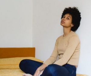 black-woman-sitting-on-bed